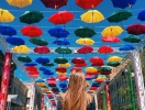 Alley of Soaring Umbrellas